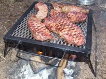 Steel pit-fire grills in 2 different sizes. Very light. Very portable. Easy to put into a pack.